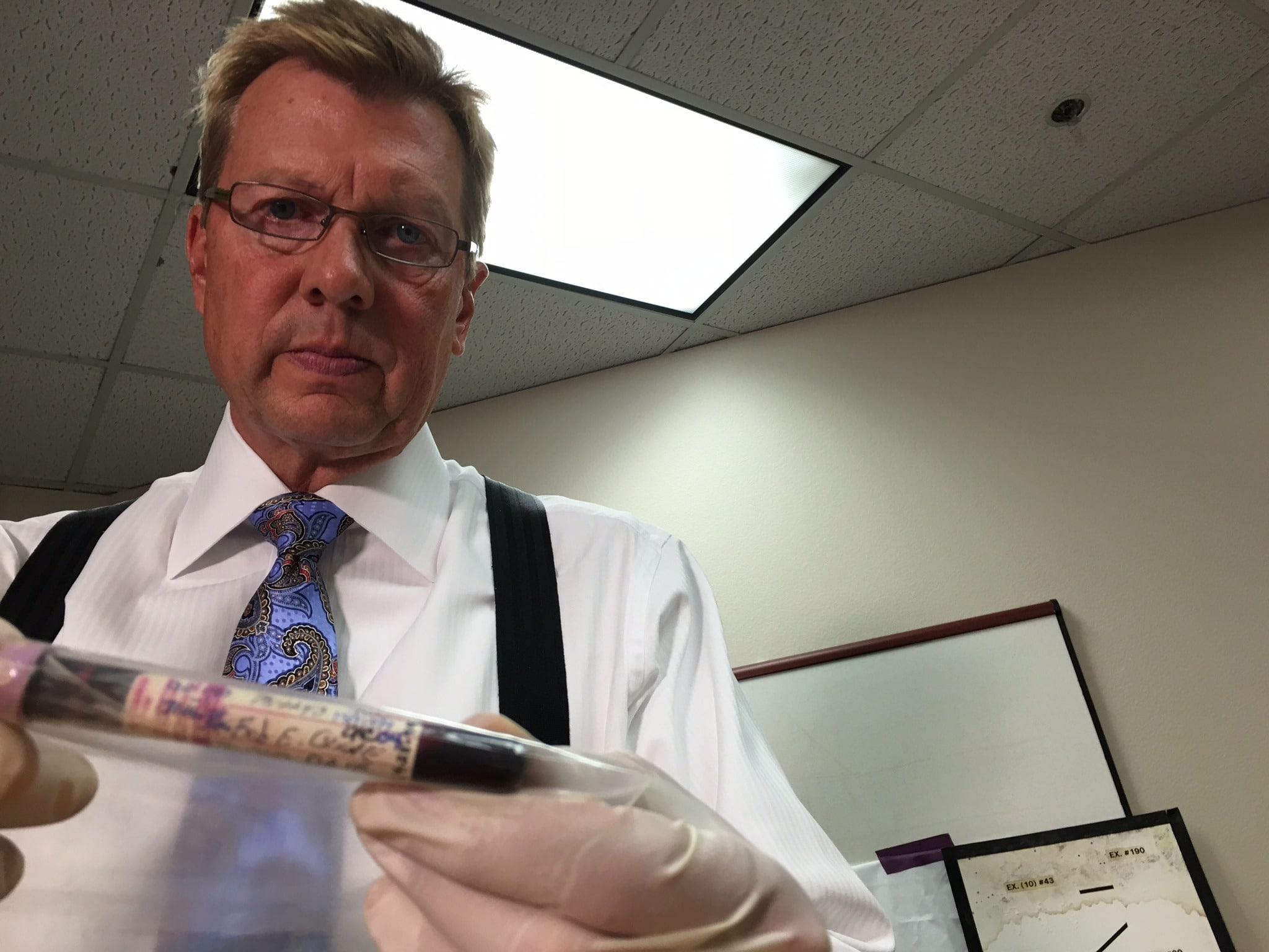 Author John Hook holds Bob Crane's blood taken from his autopsy on June 30, 1978.